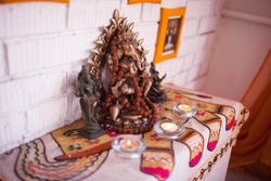 The altar of Ganesha with candles. Yoga class