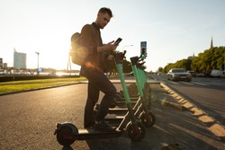 The alternative commute to the workplace. Daily transport kick scooting and e-scooting in social distancing. Fast and efficient for cities and greener alternatives. Hiring an electric scooter
