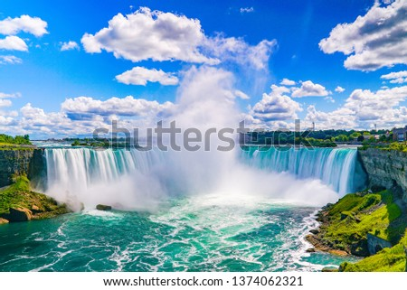 The amazing Niagara Falls is renowned for its beauty and is the collective name for three waterfalls that straddle the international border between Canada and the USA. It is a must see destination! #1374062321
