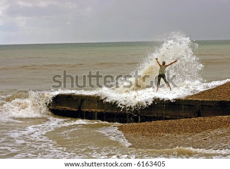 the amazing storm landcscape and jumping girl