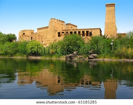 The amazing Temple of Isis at Philae island in Lake Nasser, seen from a boat. Located at 11 km of Aswan, Egypt - stock photo