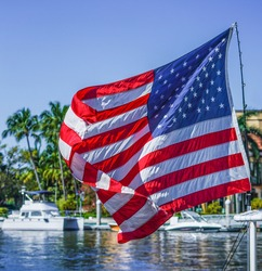 The American Flag Blows in the Wind over Boats Tied Up along the New River in Fort Lauderdale