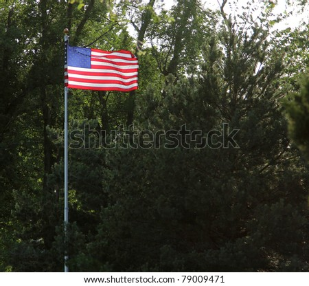 The American flag illuminated against the setting sun