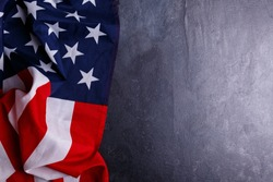 The American flag lies horizontally on the left on a gray background