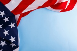 The American flag lies on the perimeter of the left and upper sides on a blue background