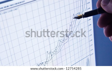 The analysis of the chart on the screen of a computer