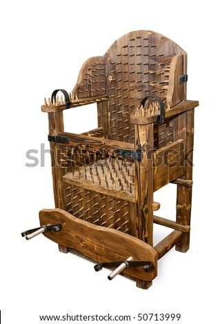 The ancient armchair for tortures isolated with clipping path
