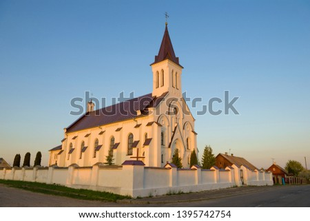 The ancient church of the Holy Trinity and the Holy Cross in April evening. Kossovo, Belarus #1395742754