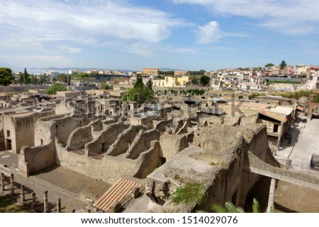The ancient city of Herculaneum, Italy. With at the background the modern city and the coastline with the harbour and the Gulf of Naples