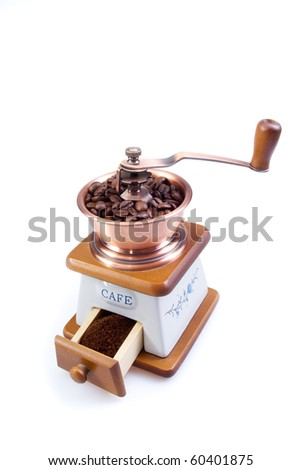 The ancient coffee grinder with coffee grains #60401875
