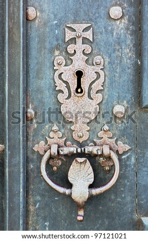 The ancient lock on the door of one of the houses in the town Evora - Alentejo, Portugal