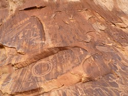 the  ancient native american petroglyphs of three fingers canyon in the san rafael swell,  from the fremont and barrier canyon periods, near green river, utah