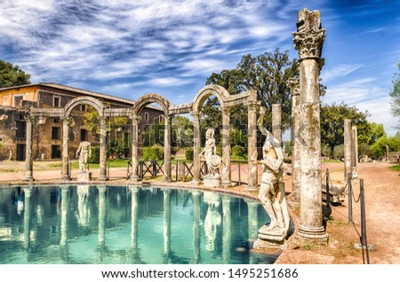 The ancient pool called Canopus, surrounded by greek sculptures in Villa Adriana (Hadrian's Villa), Tivoli, Italy Stock fotó ©