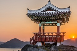 The ancient praying house on the top of mountain with view on the harbor and sunset