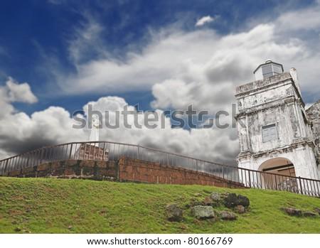 The ancient ruin of St. Paul Church in Melaka City, Malaysia, against a blue cloudy sky. St. Paul Church is a main tourist attraction in the historic city of Melaka.