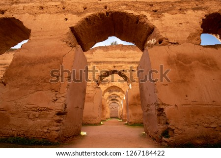 The Ancient ruined arches of the massive Royal Stables and Granaries of Moulay Ismail in the Imperial City of Meknes, Morocco near Fes. Miknasa