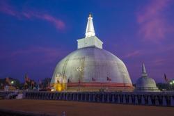 The ancient Ruwanweli Maha Seya Dagoba on evening twilight. Anuradhapura, Sri Lanka