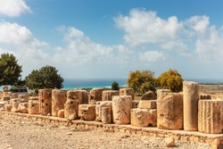 The ancient stones and columns are the preserved parts of the Aphrodite sanctuary in Kouklia, Cyprus.