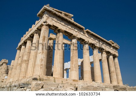 The ancient temple of Parthenon on the Acropolis of Athens, Greece, with deep blue sky behind. - stock photo