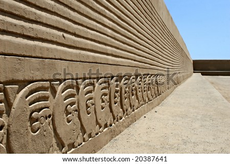 The ancient wall carvings of Chan Chan Ruins in Peru