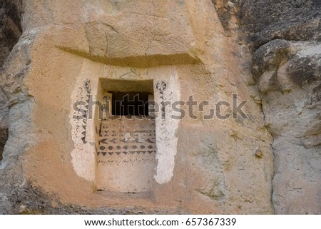 The ancient window for the bird on a chimney in Cappadocia Turkey #657367339