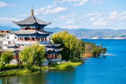 The ancient wooden Buddhist Temple on the lakeside of Erhai lake in Dali town, Yunnan province, China. Translation is