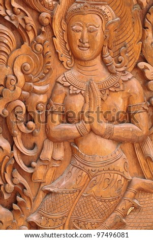 The angels are carved in the door of the temple of Wat Thai vow. - stock photo