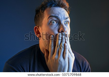 The anger and screaming man. Hate, rage. Crying emotional angry man in colorful bright lights at studio background. Emotional face. Fan human emotions, facial expression concept. #1071709868