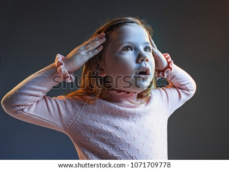 The anger and surprised teen girl. Hate, rage. Crying emotional angry teenager in colorful bright lights at studio background. Emotional face. Sport fan human emotions, facial expression concept. #1071709778