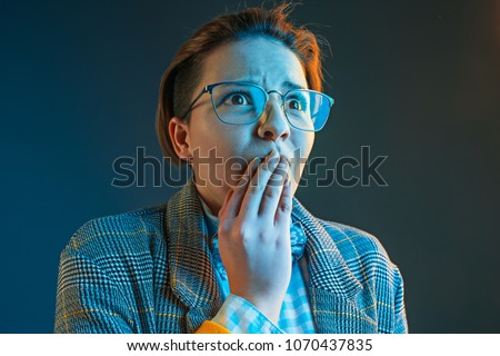 The anger and surprised woman. Hate, rage. Crying emotional angry woman in colorful bright lights at studio background. Emotional face. Sport fan human emotions, facial expression concept. #1070437835