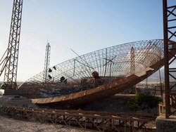 The antenna of a power plant (El Médano, Granadilla). abandoned antenna destroyed and rusty, motive of debris, aliens and outer space, transmitting antenna