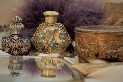 The Antique Perfume Bottles With  The Mirror and Boxes In The Vintage Mood Style