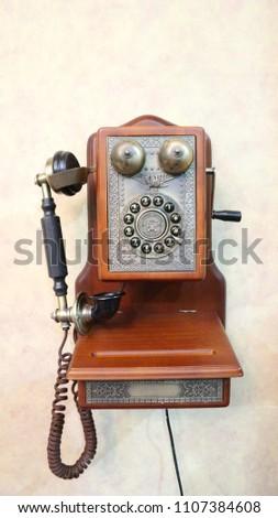 The antique telephone  #1107384608