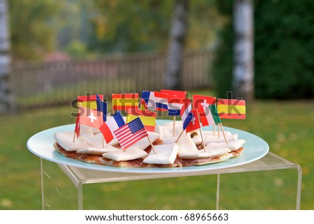The appetizer (focaccia bread and salami) with international flags