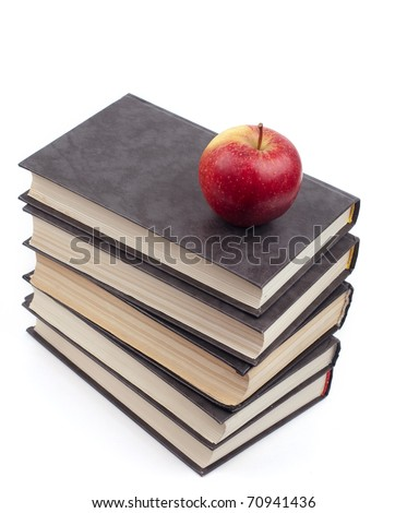 The apple lies on a pile of books