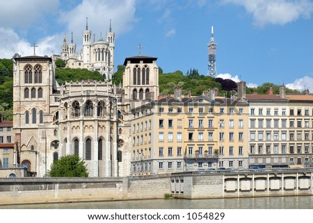 The apse of the Saint Jean cathedral, next to the Saone river, is dominated by the Fourviere basilica. (Lyon – France)