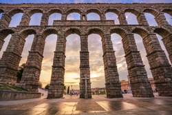 The aqueduct of Segovia, Spain, was built during the roman empire and stands as it was conceived until today. The aqueduct is built of brick-like granite blocks perfectly carved.