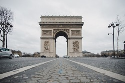The Arc de Triomphe de l'Étoile during coronavirus lockdown in Paris - Ghost City After a Lockdown - Empty streets in the centre of Paris due the lockdown because of the coronavirus - CHamps Elysees