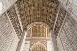 The Arc de Triomphe in Paris as seen from under the arc