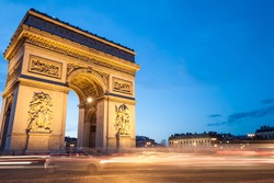 The Arc de Triomphe in Paris, France, at twilight with traffic light trails. Plenty of copy space.