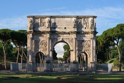The Arch of Constantine, a famous triumphal arch from the Roman Empire next to the Colosseum amphitheater in Rome, Italy