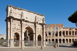 The Arch of Constantine (Arco di Costantino). Triumphal arch and Colosseum on background. Rome, Italy