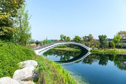 The architectural scenery of the arch bridge in Jincheng Lake Park, Chengdu, Sichuan, China