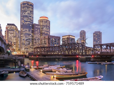 The architecture of Boston in Massachusetts, USA at night showcasing the mix of contemporary and historic architecture at Boston Harbor and Financial District. #759571489