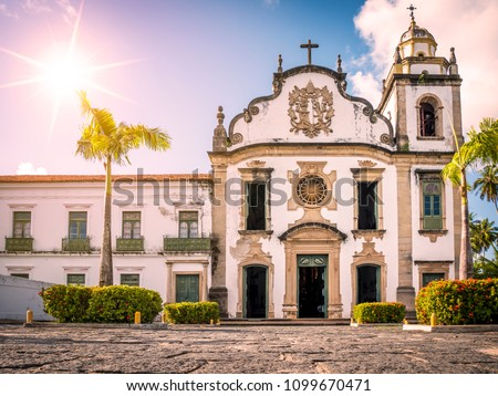 The architecture of the historic Brazilian city of Olinda in the state of Pernambuco, Brazil showcasing its cobblestone streets and colonial building at sunrise.
