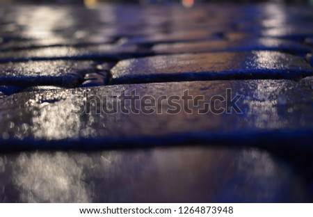 The area is lined with cobblestone or stone pavement, walkway or road. Surface of rough and rough stones.