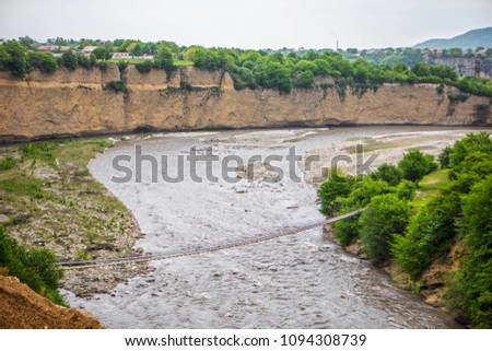 The Argun gorge — one of the largest gorges of the Caucasus on extent. Suspension bridge #1094308739
