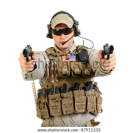The armed soldier in a camouflage costs in alertness