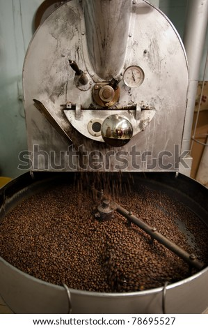 The arms of a coffee roasting machine turn to help the beans roast evenly.