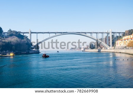 The Arrabida Bridge is an arch bridge over the Douro River. Porto.  Portugal #782669908